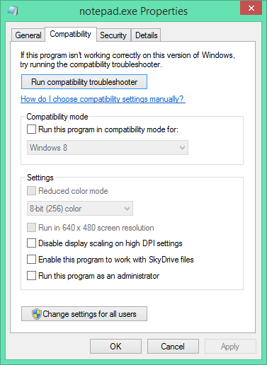 Screenshot of Notepad.exe and the Compatibility property sheet